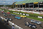 Goodwood Festival of Speed. Goodwood Sussex UK. ( Horse racing Grandstand on hill distance )