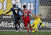 CHESTER, PA - AUGUST 12, 2012:  Zac MacMath (18) of the Philadelphia Union closes down a shot by  Alvaro Fernandez(4) of the Chicago Fire during an MLS match at PPL Park, in Chester, PA on August 12. Fire won 3-1.