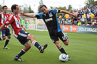Ramiro Corrales (right) kicks the ball against Nick LaBrocca (left).Chivas USA defeated the San Jose Earthquakes 2-1 at Buck Shaw Stadium in Santa Clara, California on April 23rd, 2011.