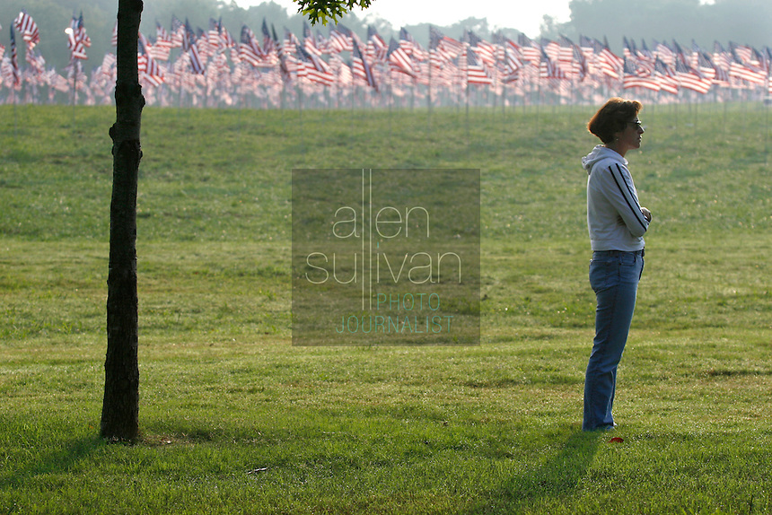 Victoria S. Aronow cries at Kennesaw Mountain National Battlefield Park during a reading of the names of people who died in the terrorist attacks of five years ago. Aronow's cousin, Richard Avery Aronow, died in the World Trade Center's north tower, she said. The Kiwanis Club of Marietta placed 2,996 flags in the park in remembrance.<br />