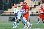 29 April 2016: North Carolina's Stephen Kelly (24) wins a draw against Syracuse's Drew Jenkins (37). The University of North Carolina Tar Heels played the Syracuse University Orange at Fifth Third Bank Stadium in Kennesaw, Georgia in a 2016 Atlantic Coast Conference Men's Lacrosse Tournament semifinal match.