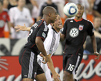 Julius James #2 of D.C. United clashes with Michael Ritchie #3 of Portsmouth FC during an international friendly match at RFK Stadium on July 24 2010, in Washington D.C. United won 4-0.