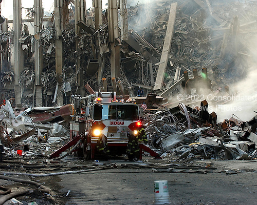 Ground Zero, New York City, N.Y. - Sept. 16, 2001 -- A lone fire engine at the crime scene in Manhattan where the World Trade Center collapsed following the September 11, 2001 terrorist attack on September 16, 2001.  Surrounding buildings were heavily damaged by the debris and massive force of the falling twin towers.  Clean-up efforts are expected to continue for months.  .Credit: Eric J. Tilford - US Navy via CNP