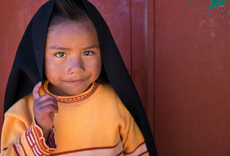 TAQUILE ISLAND, PERU - CIRCA APRIL 2014: Portrait of girl in Taquile Island, Peru.