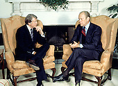 United States President Gerald R. Ford, right, meets U.S. President Elect Jimmy Carter, left, in the Oval Office of the White House in Washington, D.C. to discuss the transition on November 22, 1976.  This is the first meeting between the two men since the Presidential debates during the campaign.<br /> Credit: Benjamin E. &quot;Gene&quot; Forte / CNP