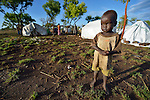 A boy in a camp for displaced people in Melijo, South Sudan, near that country's border with Uganda. Families here fled fighting around Bor, in Jonglei State, in December 2013, but have not been warmly welcomed to this region of Eastern Equatoria State, where two earlier waves of displaced people in the 1980s and 1990s have left relations tense between the newcomers, who are Dinka, and the largely Ma'adi residents around the city of Nimule. The ACT Alliance is helping the displaced families and the host communities affected by their presence, and is supporting efforts to reconcile the two groups.
