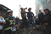 Standing on the ashes of the terrorist attack upon the World Trade Center in New York, New York, Friday, September 14, 2001, United States President George W. Bush pledges that the voices from across America calling for justice will be heard. Standing with the President is retired fireman Bob Beckwith..Mandatory Credit: Eric Draper - White House via CNP.