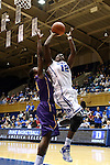 19 December 2013: Duke's Chelsea Gray (12) and Albany's Tammy Phillip (BVI) (14). The Duke University Blue Devils played the University at Albany, The State University of New York Great Danes at Cameron Indoor Stadium in Durham, North Carolina in a 2013-14 NCAA Division I Women's Basketball game. Duke won the game 80-51.