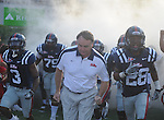 Ole Miss head coach Houston Nutt leads the team into Vaught-Hemingway Stadium in Oxford, Miss. on Saturday, September 10, 2011. Ole Miss won 42-24.