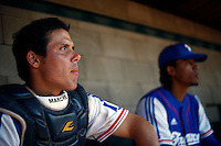 24 June 2011: Boris Marche of Team France. Illustration of a photographic essay called Life in the dugout, during France 8-5 win over UCLA Alumni, at the 2011 Prague Baseball Week, in Prague, Czech Republic.