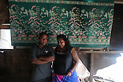 Tiaon Bwere and his wife, of Betio village, in their house which was smashed the previous day by the 'king tides' which came ashore on the South Pacific island of Kiribati. The property was damaged by the large waves, and they now face the prospect of rebuilding their home. They wish to seek assistance from the government of Kiribati.