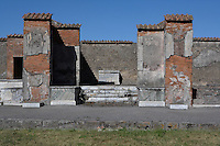Shrine in the Macellum, on Pompeii, 2nd century BC. The  covered food market, is North East of the Forum. This shrine, with the altar in the centre, was dedicated to the Imperial household