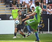 Alejandro Moreno #15 of the Philadelphia Union sends a cross past Leonardo Gonzalez #19 of the Seattle Sounders FC during the first MLS match at PPL stadium in Chester, PA. on June 27 2010. Union won 3-1.
