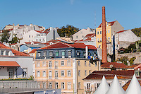 Lisbon, November 2012. Alfama district. Tradotional houses and an ancien industrial chimney.