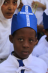 Israel, Jerusalem, Ethiopian Orthodox child at the Church of the Holy Sepulchre on Palm Sunday