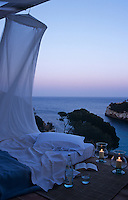 A mattress on the terrace for sleeping out under the stars has a view of the Mediterranean beyond