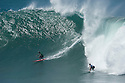 Kala Alexander (HAW) and Ross Clark Jones (AUS) during the Quiksilver Eddie Aikau at Waimea Bay on the Northshore of Oahu in Hawaii