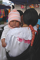 Indigenous Otovalan infant with mother. Otovalo, Ecuador.