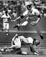 Giant shortstop Robbie Thompson makes doubleplay with Dodger Mike Scioscia out at 2nd. (1986 photo by Ron Riesterer)