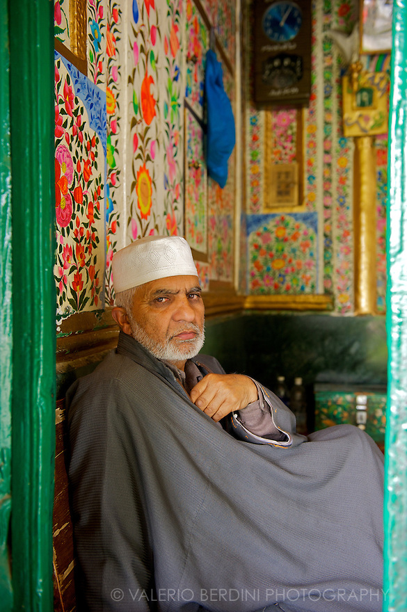 A Muslim priest at the entrance of a Mosque in the old town of Srinagar.