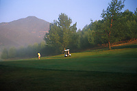 Golfer, morning mist, hitting ball, fairway, golf cart