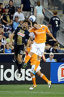 Veljko Paunovic (16) of the Philadelphia Union and Bobby Boswell (32) of the Houston Dynamo. The Philadelphia Union and the Houston Dynamo played to a 1-1 tie during a Major League Soccer (MLS) match at PPL Park in Chester, PA, on August 6, 2011.