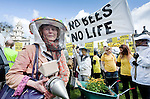 'March of the beekeepers'. Protest by beekeepers and members of the public against DEFRA minister Owen Paterson's opposition to a proposed EU ban on the use of neonicotinoid pesticides, which many leading scientists (including those on the House of Commons' own Environmental Audit Committee) believe is killing bees in alarming numbers (3 species of bee are already extinct). The protest was organised by Avaaz, 38 Degrees and other organisations, who have been campaigning on the issue for many months, with public petitions in support of a ban on neonicotinoids already reaching over 2.6 million signatures. Parliament Square, Westminster, London, UK (26 April 2013)