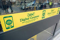 The new Whole Foods Market in Newark, NJ promotes digital coupons, seen on opening day Wednesday, March 1, 2017. The store is the chain's 17th store to open in New Jersey. The 29,000 square foot store located in the redeveloped former Hahne & Co. department store building is seen as a harbinger of the revitalization of Newark which never fully recovered from the riots in the 1960's.  (© Richard B. Levine)