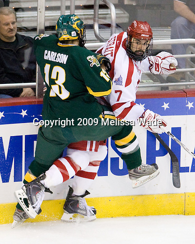 Corey Carlson (Vermont - 13), Brian Strait (BU - 7) - The Boston University Terriers defeated the University of Vermont Catamounts 5-4 on Thursday, April 9, 2009, in the 2009 Frozen Four Semi-Final at the Verizon Center in Washington, DC.