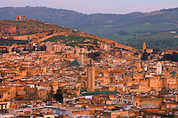 General view of Fez, Morocco, pictured on February 26, 2009 in the warm morning light with the mountainous landscape in the background. Fez, Morocco's second largest city, and one of the four imperial cities, was founded in 789 by Idris I on the banks of the River Fez. The oldest university in the world is here and the city is still the Moroccan cultural and spiritual centre. Fez has three sectors: the oldest part, the walled city of Fes-el-Bali, houses Morocco's largest medina and is a UNESCO World Heritage Site;  Fes-el-Jedid was founded in 1244 as a new capital by the Merenid dynasty, and contains the Mellah, or Jewish quarter; Ville Nouvelle was built by the French who took over most of Morocco in 1912 and transferred the capital to Rabat. Picture by Manuel Cohen.