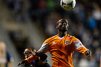 Omar Cummings (7) of the Houston Dynamo keeps the ball from Fabio Alves (Fabinho) (33) of the Philadelphia Union. The Houston Dynamo defeated the Philadelphia Union 1-0 during a Major League Soccer (MLS) match at PPL Park in Chester, PA, on September 14, 2013.
