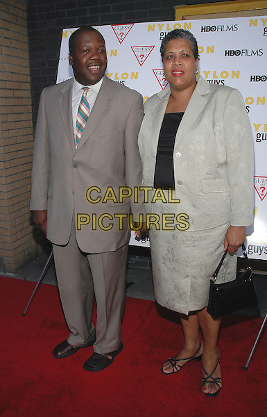 """THADDEUS THOMPSON & WIFE.The premiere of the new film, """"Last Days"""".New York, 19th July 2005.full length full-length grey suit skirt couple.Ref: Patti Ouderkirk.www.capitalpictures.com.sales@capitalpictures.com.© Capital Pictures."""