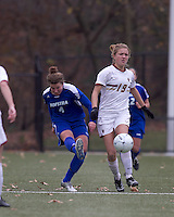 Hofstra University defender Amy Turner (4) clears ball away from Boston College forward Kristen Mewis (19). Boston College defeated Hofstra University, 3-1, in second round NCAA tournament match at Newton Soccer Field, Newton, MA.