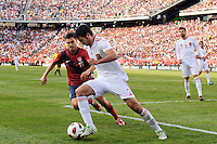 Raul Albiol (2) of Spain plays the ball under pressure from Chris Wondolowski (11) of the United States. The men's national team of Spain (ESP) defeated the United States (USA) 4-0 during a International friendly at Gillette Stadium in Foxborough, MA, on June 04, 2011.