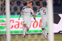 LA Galaxy forward Chad Barrett (11) celebrates his goal with teammate Sean Franklin (5). The LA Galaxy defeated the Portland Timbers 3-0 at Home Depot Center stadium in Carson, California on  April  23, 2011....