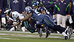 Philadelphia Eagles wide receiver DeSean Jackson is tackled by Seattle Seahawks linebacker Leroy Hill and free safety Earl Thomas at CenturyLink Field in Seattle, Washington on December 1, 2011. The Seahawks beat the Eagles 31-14. ©2011 Jim Bryant Photo. All Rights Reserved.