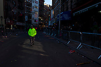 New York, United States. 17th February 2013 -- A man walks on a empty street after Chinese residents took part of the lunar new year at the China Town in New York. Photo by Eduardo Munoz Alvarez / VIEWpress.