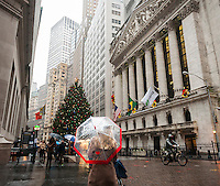 The front of the New York Stock Exchange on Wednesday, November 30, 2016 with their Christmas tree and the facade decorated with wreaths.  (© Richard B. Levine)