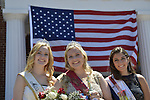 Wantagh, New York, USA. July 4, 2016. L-R,  KERI BALNIS, Miss Wantagh 2015; EMMA CAREY, Miss Wantagh 2016; and BRIANNA COLTELLINO, 1st Runner Up Miss Wantagh 2016; pose in front of large American Flag at the 60th Annual Miss Wantagh Pageant, an Independence Day tradition on Long Island. Since 1956, the Miss Wantagh Pageant, which is not a beauty pageant, crowns an area high school student based mainly on academic excellence and community service.