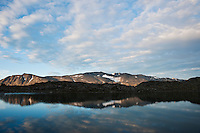 Mountain reflection in lake Blørnbøljønne on Besseggen trail, Jotunheimen naitonal park, Norway