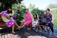 Members of 'Me N Ma Girls', Myanmar's first girl band, relax by a swimming pool during a break in the filming of a video. The band's members were recruited by Australian dancer Nicole May. They sing and dance in the manner of many Western pop acts but in socially conservative Myanmar, they represent a radical break from the norm.