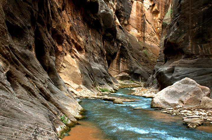 The Narrows of Parunuweap Canyon can make for slow hiking, it's easy to slip on the wet slickrock bottom of this slot.