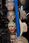 Masks of members of the Uk royal family including the Queen at the top, appear in a shop window in central London.ahead of a weekend of nationwide celebrations for the monarch's Diamond Jubilee. A few months before the Olympics come to London, a multi-cultural UK is gearing up for a weekend and summer of pomp and patriotic fervour as their monarch celebrates 60 years on the throne and across Britain, flags and Union Jack bunting adorn towns and villages.