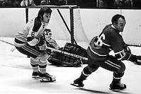 Seals vs Montreal: Bob Stewart, and goalie Gilles Meloche..(1973 photo/Ron Riesterer)