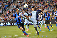 Ike Opara (3) defender Sporting KC gets to the ball ahead of Colleen Warner (18) midfield Montreal Impact .<br /> Montreal Impact defeated Sporting Kansas City 2-1 at Sporting Park, Kansas City, Kansas.