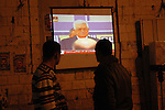 Palestinians watch the  President Mahmoud Abbas as he delivers speech during a celebration marking the 45th anniversary of the Fatah movement's founding, in the West Bank city of Nablus,Thursday, Dec 31, 2009. Photo By Nedal Shtieh
