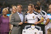 CARSON, CA - October 16, 2011: LA Galaxy's head coach Bruce Arena presents defender Gregg Berhalter with a signed jersey celebrating Berhalter career after the match between LA Galaxy and Chivas USA at the Home Depot Center in Carson, California. Final score LA Galaxy 1, Chivas USA 0.