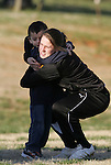 20 March 2009: Sky Blue's (and former UNC player) Heather O'Reilly hugs the son of UNC assistant coach Bill Palladino. The WPS's Sky Blue FC played the University of North Carolina Tar Heels in a preseason game at Macpherson Stadium in Brown's Summit, North Carolina.