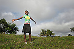 """Maudeline Raymond, a member of Nouvel Etwal - Haitian Kreyol for """"New Stars"""" - dances on a hillside in Mizak, Haiti. Nouvel Etwal is a dance and creative movement group of 16 girls from age 8 to 13, based in the southern village of Mizak. According to Valerie Mossman-Celestin, an organizer of the group, """"Nouvel Etwal seeks to empowers girls to be self-confident and creative. The girls learn flexibility, discipline and teamwork, lessons they also need for life. Nouvel Etwal promotes health, well-being and enhanced self-worth. The girls are encouraged to live into a brighter future where girls and women are valued,  educated, and have equal opportunity to achieve their potential."""""""