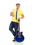 Portrait of a happy smiling young man guitar player standing with an acoustic guitar isolated on white background